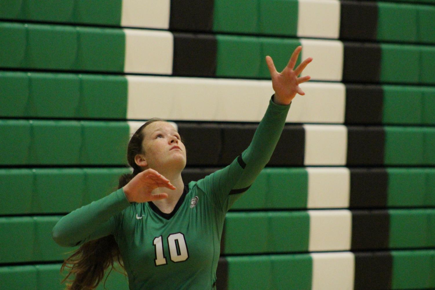 Freshman+Addy+Brown+serves+the+ball+in+the+first+set+against+Newton