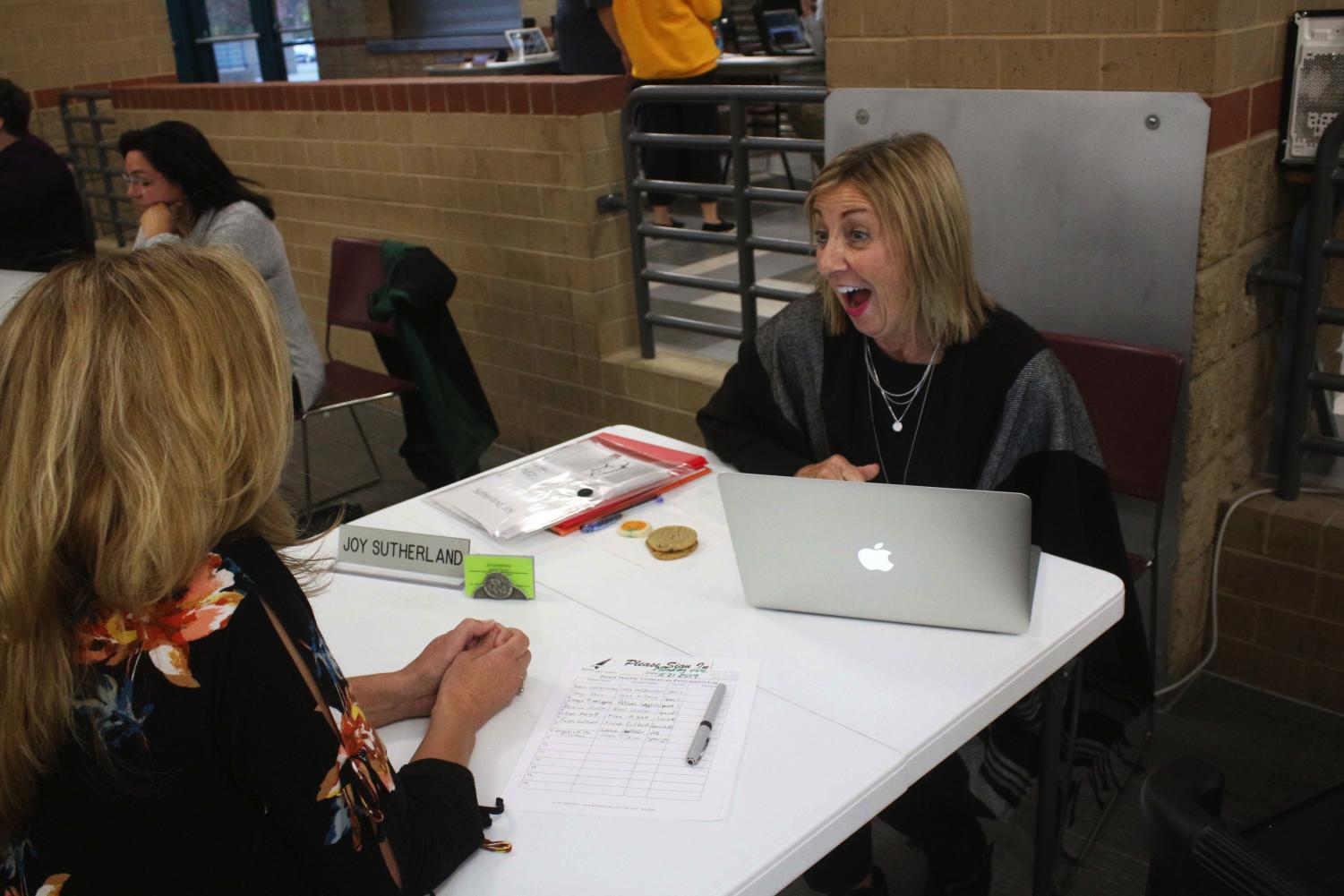 Spanish teacher Joy Sutherland talks to a parent during fall conferences on Oct. 21.