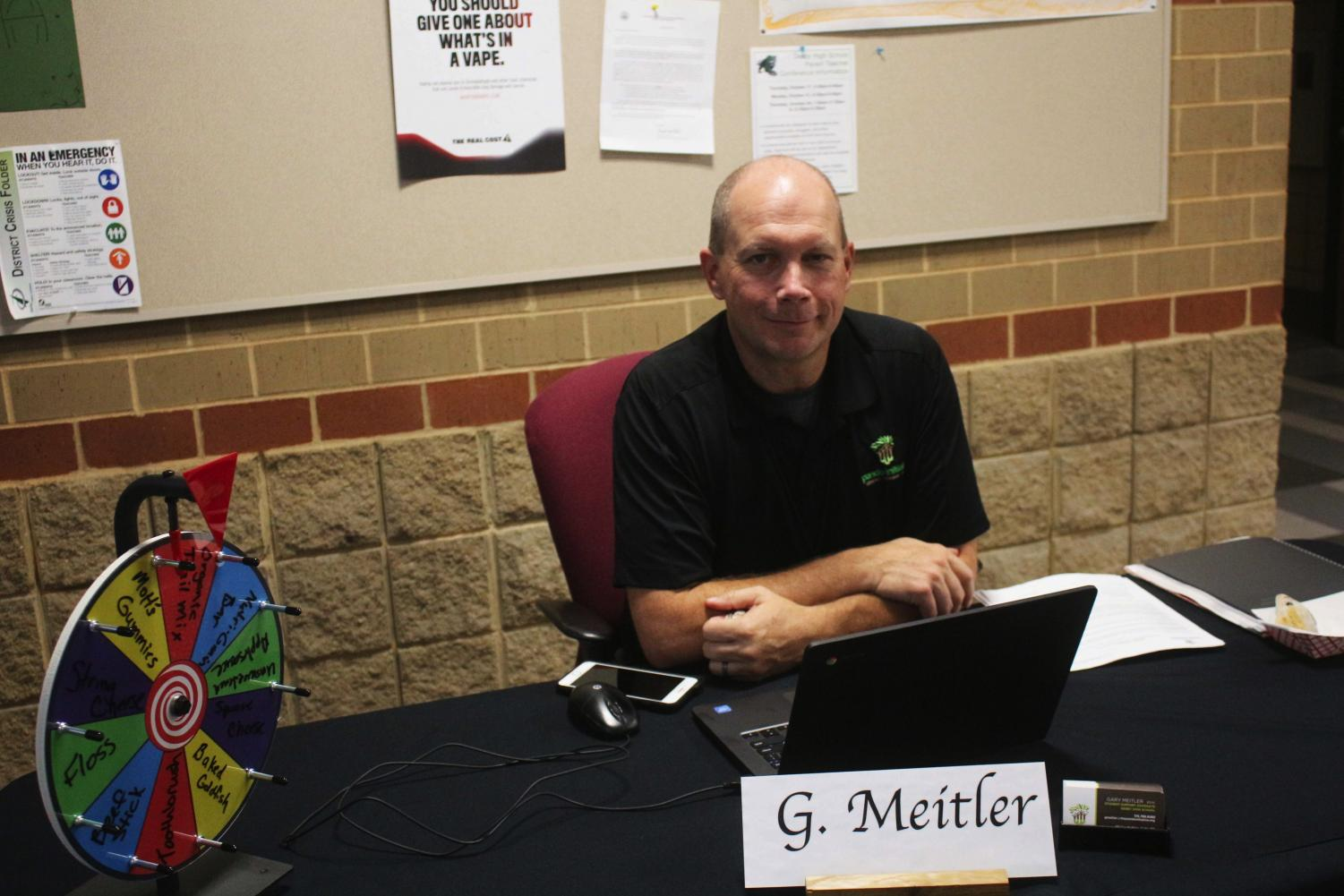 Gary+Meitler+helps+students+in+need+of+school+supplies+at+conferences+Oct.+21