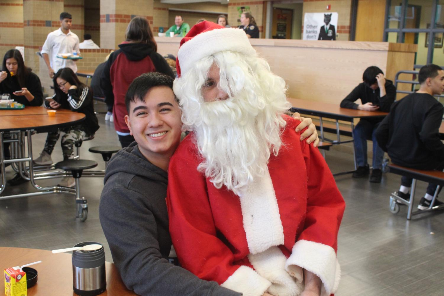 A+student+poses+for+a+photo+with+Santa