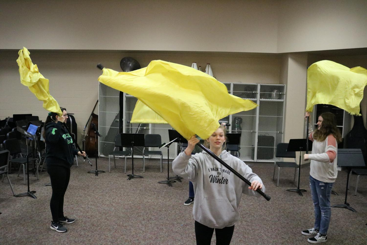Color guard blocks into a group of four to run fight song for the 5/10 pep assembly.