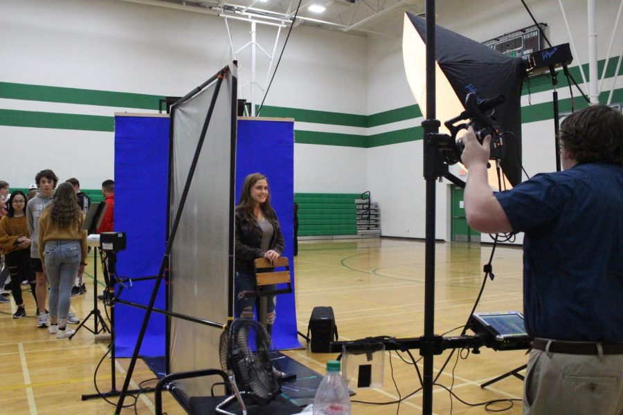Saige Nettleton poses as her pictures are being retaken