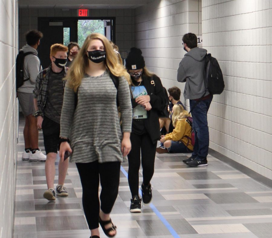 Students+walk+into+K-building+after+getting+off+the+bus+on+Sept.+8%2C+the+first+day+of+school.+Photo+by+Cooper+Chadwick