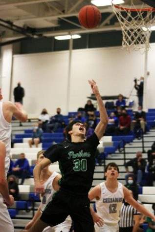 Boys basketball vs. Kapaun Mount Carmel (Photos by Reese Cowden)